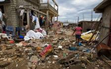 A woman walks along the waterfront in the western city of Jeremie on Thursday October 6, 2016. Hurricane Matthew passed over Haiti on Tuesday October 4, 2016, with heavy rains and winds. Picture: AFP.