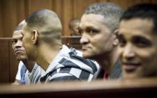 An alleged leader of the 28s gang, George Thomas, and his 17 co-accused in court on 4 May 2015, they collectively face 166 charges ranging from murder to attempted murder. Picture: Thomas Holder/EWN.