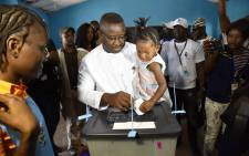 Sierra Leone's people party presidential candidate and former general, Julius Maada Bio, casts his ballot at the polling station in the final round of a delayed run-off presidential election on 31 March 2018 in Freetown. Picture: AFP