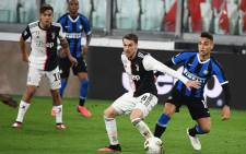Juventus midfielder Aaron Ramsey (2ndR) vies with Inter Milan forward Lautaro Martinez during the Italian Serie A football match at the Juventus stadium in Turin on 8 March 2020. Picture: AFP