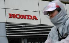 FILE: The logo of Japan's Honda Motor Co. is displayed at the company's headquarters in Tokyo on 2 February 2018. Picture: AFP