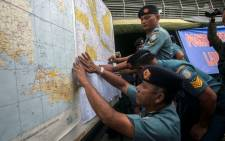 Indonesian Air Force officials show maps to journalists of the search area for the missing Malaysian air carrier AirAsia flight QZ8501, at the airport in Surabaya, East Java, on December 29, 2014. Picture: AFP.