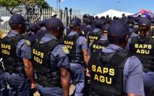Members of the SA Police Service's Anti-Gang Unit are seen in Hanover Park, Cape Town, during the launch of the specialised unit on 2 November 2018. Picture: @SAgovnews/Twitter