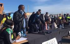 Bulelani Qholani addresses the community during a visit by Police Minister Bheki Cele on Saturday, 4 July 2020. Picture: Jarita Kassen/EWN.