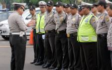 FILE: Indonesian police attend their morning briefing before taking part in their duties. Picture: AFP