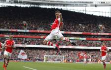 Arsenal's French striker Olivier Giroud celebrates scoring his 1-0 during the English Premier League football match between Arsenal and West Ham United at The Emirates Stadium in London on March 14, 2015. Picture: AFP