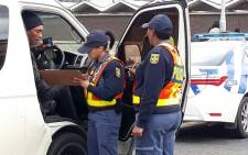 FILE: SA Police Service officers are seen during a roadblock in Cape Town. Picture: SAPS
