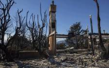 The ruins of an ocean view home are seen in the aftermath of the Woolsey Fire in Malibu, California on November 14, 2018.  Picture: AFP.