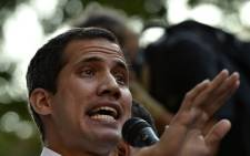 Venezuelan opposition leader and self-proclaimed interim president Juan Guaido speaks during a rally in San Bernardino neighbourhood in Caracas on 1 April 2019. Picture: AFP