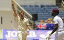 Australia's Shane Watson reacts on taking the wicket of West Indies' Jason Holder (R) on day four of the second cricket Test between Australia and the West Indies on 14 June 2015 at Sabina Park in Kingston, Jamaica. Picture: AFP