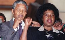 FILE: Anti-apartheid leader and ANC member Nelson Mandela and wife Winnie raise fists upon his release from Victor Verster prison, 11 February 1990 in Paarl. Picture: AFP.