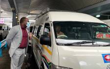 Western Cape Transport MEC Bonginkosi Madikizela (L) assesses Covid-19 compliance at the Cape Town Taxi Rank. Picture: Kaylynn Palm/EWN.