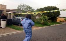 A house has been cordoned off by police after a police officer allegedly shot his girlfriend and apparently took his own life in Strand. Picture: Lauren Isaacs/EWN.