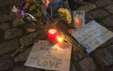 FILE: A makeshift memorial on a downtown street one block away from Canada's National War Memorial in Ottawa where soldier Nathan Cirillo was shot and killed while on guard duty on 22 October 2014. Picture: EPA.
