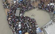 In this aerial photo taken on June 27, 2021, people board a ferry as authorities ordered a new lockdown to contain the spread of the Covid-19 coronavirus, in Munshiganj, in central Bangladesh. Picture: Munir Uz zaman / AFP