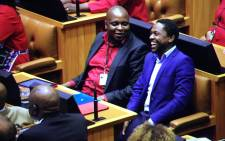 The EFF's Floyd Shivambu and Mbuyiseni Ndlozi share a laugh during the 2015 SONA debate in Parliament on 17 February 2015. Picture: Thomas Holder/EWN