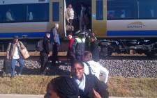 Gautrain passengers climb out of the train, after it stopped unexpectedly in Centurion on 17 July 2012. Picture: Julius/iWitness.