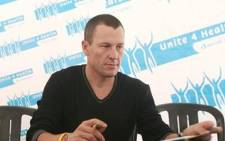 Disgraced professional cyclist Lance Armstrong has been charged with crashing into two parked cars. Picture: AFP.