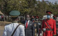 Malawi President Lazarus Chakwera (2nd L) inspects a parade after he received a sword of office, as Commander in-Chief of the Malawi Armed Forces, from Commander of the Malawi Defence Force, General Peter Namathanga, during his inauguration at the Kamuzu Baracks, the Malawi Defence Force Headquarters, in Lilongwe on 6 July 2020. Picture: AFP