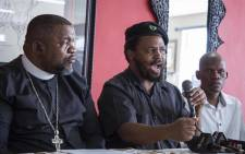 The leader of the Black First Land First Movement, Andile Mngxitama, alongside Bishop Timothy Ngcobo during a press conference detailing the activities to support former president Jacob Zuma ahead of his court appearance. Picture: Ihsaan Haffejee/EWN