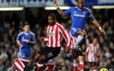 Chelsea's Ivorian Didier Drogba (R) jumps over a challenge from Sunderland's Titus Bramble (C) and Lee Cattermole (L) on November 14 2010. Picture: AFP.