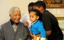 Grandchildren wishing Nelson Mandela a happy 94th birthday at his home in Qunu, Eastern Cape, South Africa. Picture: Peter Morey