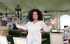 Oprah Winfrey with some items from her 'biggest yard sale ever' which raised around R6 million for an SA charity. Picture: Oprah Winfrey Facebook Page.