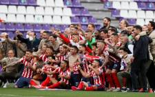 Atletico Madrid fans watched on their phones on Saturday, 22 May 2021, while Atletico fell behind to 19th-placed Real Valladolid, only to come back to claim a 2-1 win. Picture: Twitter/ @LaLigaEN
