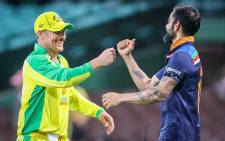 Australia's captain Aaron Finch (L) bumps fists with India's captain Virat Kohli after victory during the one-day international cricket match at the Sydney Cricket Ground (SCG) in Sydney on November 27, 2020. Picture: AFP