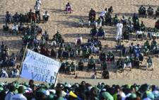 "FILE: Supporters of the Senegalese ""Parti de l'Unite et du Rassemblement"" (PUR) gather on 3 February 2019, at the municipal stadium of Thiaroye, a suburb of Dakar, as campaigning for the upcoming Senegalese presidential election of 24 February kicks off. Picture: AFP"