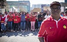 The demonstrators from the Communication Workers Union making their way to the Johannesburg Stock Exchange to hand over a memorandum of demands. Picture: Thomas Holder/EWN