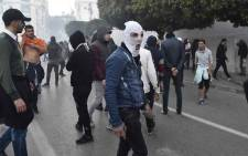 FILE: A picture taken on 22 February 2019 shows Algerian protesters as police in riot gear fired tear gas and set up a security cordon to block access to the presidential palace by the demonstrators who responded with stone-throwing. Picture: AFP.