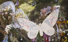 Flowers and notes left on the Lower Tokai Park fence in the days following the murder of teenager Franziska Blochliger. Picture: Aletta Harrison/EWN.