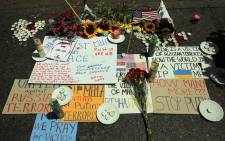 A memorial to those killed on the Malaysia Airlines flight sits on the sidewalk outside the Netherlands Consulate General in New York on July 18, 2014 in New York City. Picture: AFP.