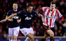 Manchester United's Michael Carrick fights for the ball with a Sunderlands player at the Stadium of Light during the first leg of the League Cup semi-final. Picture: Facebook.