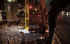 A man in Soweto pours the alcohol he had in his possession during a police operation on Saturday, 06 June 2020, on the first weekend since the level 3 lockdown which permits the sale of alcohol. Picture: Kayleen Morgan/EWN