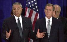 FILE: Former chairman of the Joint Chiefs of Staff, General Colin Powell (L), answers questions after US President-elect George W. Bush (R) nominated Powell for Secretary of State 16 December 2000 in Crawford, Texas. Vice President-elect Dick Chaney stands in the background. Picture: AFP Photo/Tannen MAURY