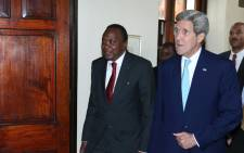 Kenyan president Uhuru Kenyatta receives US Secretary of State, John Kerry on official state visit on 4 May 2015. Picture: Uhuru Kenyatta official Facebook page.