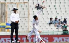 FILE: South Africa's Dean Elgar bowls during a recent Test against India. Picture: AFP