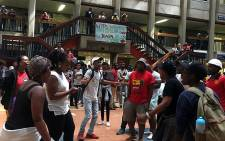 FILE: Wits Fees Must Fall members protest as first year students queue around them for registration. Picture: EWN
