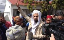 """Protesters from the Muslim faith gathered outside the new """"open mosque"""" in Wynberg on 19 September 2014. Picture: Aletta Garner/EWN"""
