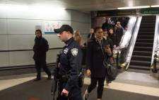 FILE: Port Authority Police watch as people evacuate after a reported explosion at the Port Authority Bus Terminal on 11 December 2017 in New York. Picture: AFP.