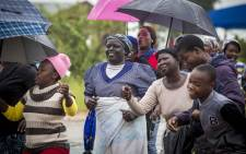 Protesters in Vuwani sing and dance along the road. Picture: Thomas Holder/EWN.