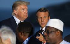 FILE: US President Donald Trump (L) and France's President Emmanuel Macron talk prior to a family picture with G7 leaders and guests, on the second day of the annual G7 summit in Biarritz, south-west France on 25 August 2019. Picture: AFP.