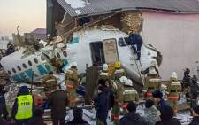 This handout picture taken on 27 December 2019 and released by Kazakhstan's emergency committee shows rescuers working at the site of a passenger plane crash outside Almaty. Picture: AFP