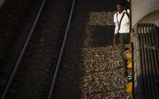 School people holding on an overcrowded train from Mzimhlophe Station to Park Station in Johannesburg. Picture: Sethembiso Zulu/EWN