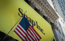 FILE: A banner for Snap Inc. IPO is seen outside at the New York Stock Exchange on 2 March, 2017 in New York. Picture: AFP.