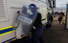 FILE: Tensions broke out in Nomzamo informal settlement near Strand as residents fought to avoid eviction on 3 June 2014. Picture: Carmel Loggenberg/EWN.