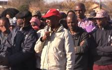 Khutsong residents gather at nearby field to talk about gangs terrorizing community. Picture: Kgothatso Mogale/EWN