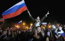 FILE: Pro-Russian supporters wave Russian flags. Picture: AFP.